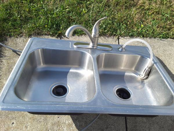 Photo Used stainless steel sink with Moen faucet - $45 (NEWARK)