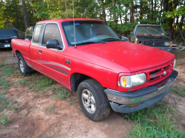 Photo 1997 Mazda B4000 Parts parting out Hood front clip transmission bed - $1 (Harris County)