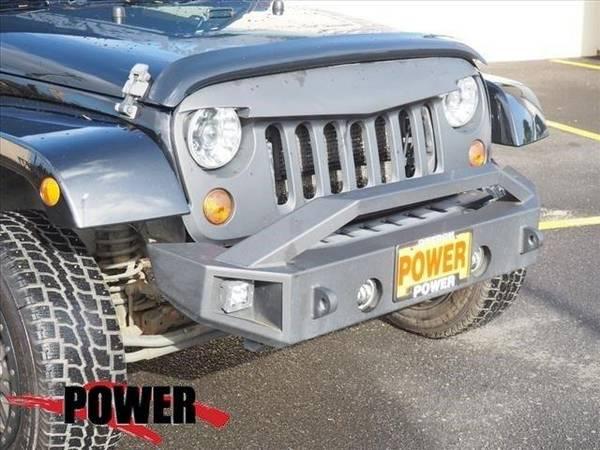 Photo 2012 Jeep Wrangler Unlimited SUV Altitude - Black (Jeep_ Wrangler_ Unlimited_ SUV_)
