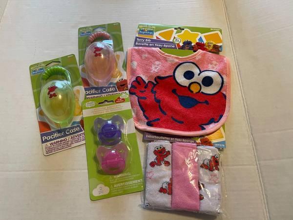 Photo NEW Sesame Street Elmo baby girl lot  pink bib washcloths 2 pacifiers - $10 (Albany - porch pickup off Waverly near Lexington Park)