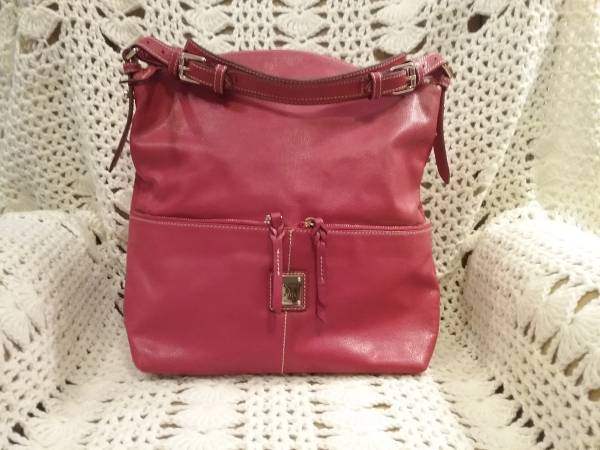 Photo Dooney and Bourke leather purse - $75 (Briargate)