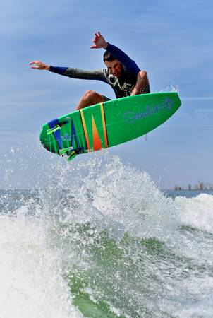 Looking for a wakesurf boat cash or trade or both - $44,444 (Denver)