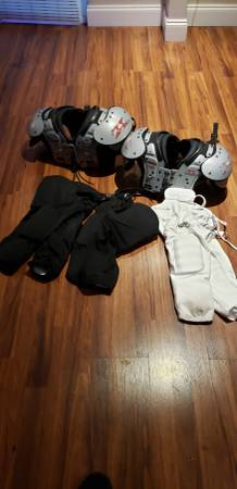 Photo Two shoulder pads $20 each, Football Pants 3 for $10 - $45 (N Fort Worth)