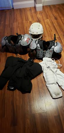 Photo Two shoulder pads $20 each Helmet $25 Football Pants 3 for $10 - $55 (N Fort Worth)