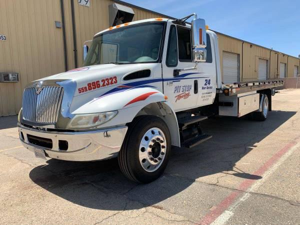 Photo International 4300 DT466 Rollback Tow Truck - $50000