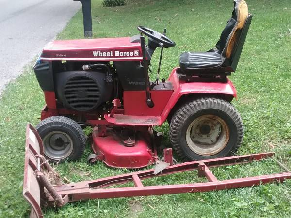 Photo Wheel Horse Mower with snow plow - $650