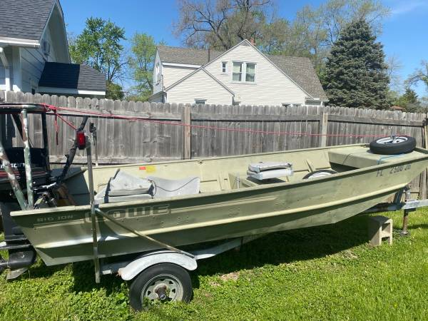 Photo 1995 Lowe Jon boat motor and trailer - $1,200 (Creve Coeur)