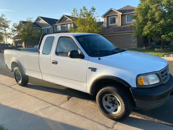 Photo F150 ford v8 4x4 XL long bed and new tires - $5,899 (Aurora)