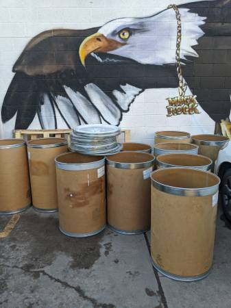 Photo Free 55 gallon cardboard drums and 5 gallon buckets
