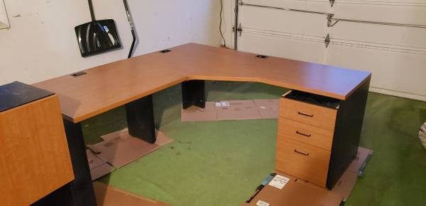Photo Large L Shaped Desk with Hutch, Drawers, and Keyboard Tray - $600 (Englewood)