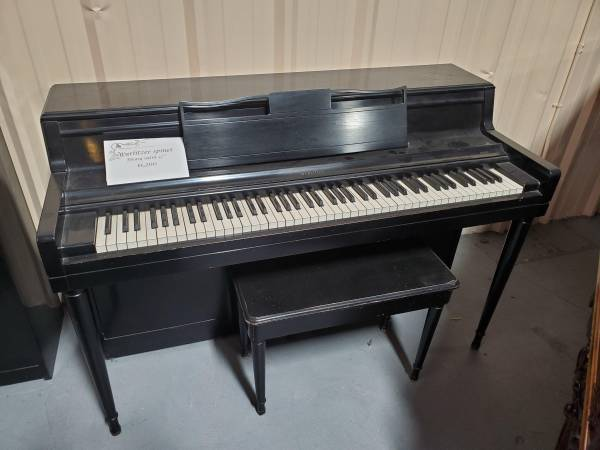 Photo Wurlitzer ebony satin spinet piano - $800 (SW Denver)