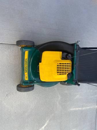 Photo Yard man lawnmower - $20