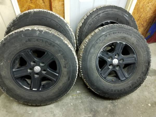 Photo 17 inch black dodge ram rims with tires - $400 (Earling iowa)