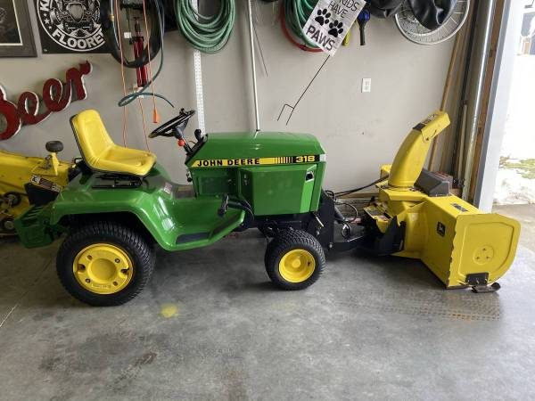 Photo John Deere Quick Hitch and Snowblower 318, 322, 332 - $2,800 (Muscatine)