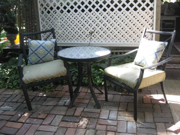Photo patio bistro set .. glass top table 2 chairs w cushions. - $125 (WEST DES MOINES)