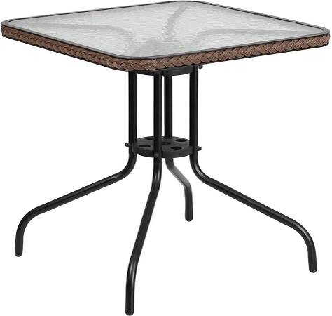 Photo Glass top outdoor patio table - NEW - $50 (TAYLOR)