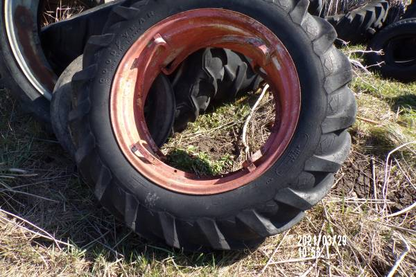 Photo FOR SALE-FOUR RAIL TRACTOR RIM  TIRE AC WD OR WD45 - $120 (Strawberry Point, IA)