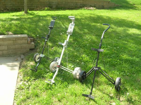 Photo PULL GOLF CARTS - $15 (EAST DUBUQUE, IL.)