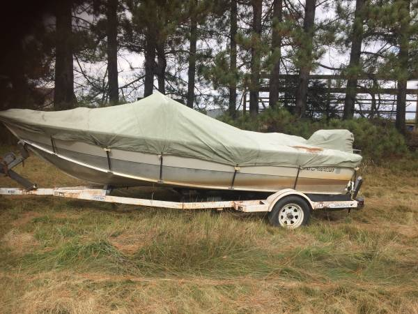 Photo Boat motor an trailer - $500 (Aurora)