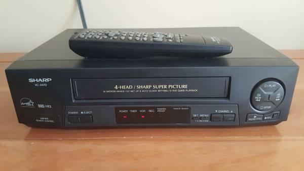 Photo Sharp VCR wremote and VHS Movies - $125 (Canyon)