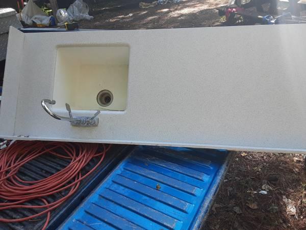 Photo Corian counter, sink and faucet - $160 (Eden)