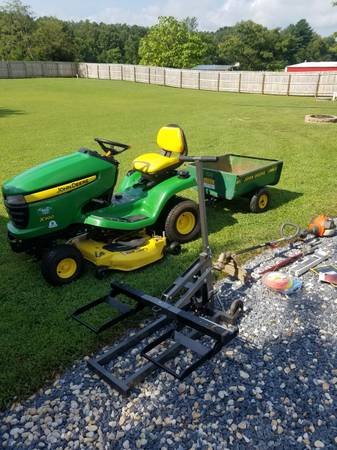 Photo John Deere X300  trailer and more - $1,850 (Worton)