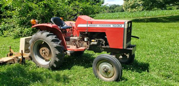 Photo One-owner Massey Ferguson MF 1030 diesel tractor, wtwo mowers, blade - $5,000 (Chestertown)