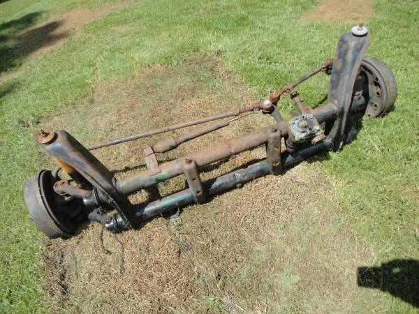 Photo VW FRONT AXLE BEAM WITH 4 LUG DRUM BRAKES AND STEERING - $175 (Easton)