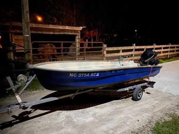 Photo 14 foot fiberglass Jon boat with 15 four stroke - $2,750 (New Bern)