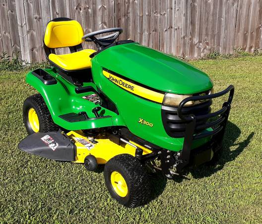 Photo John Deere X300 Riding Lawn Mower NEW Hood Brush Guard Seat - $1,700 (Goldsboro)