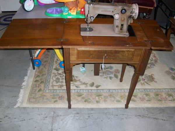 Photo Sew Table  Singer Sewing Machine (needs cord) - $30 (4691 Reedy Branch Rd)