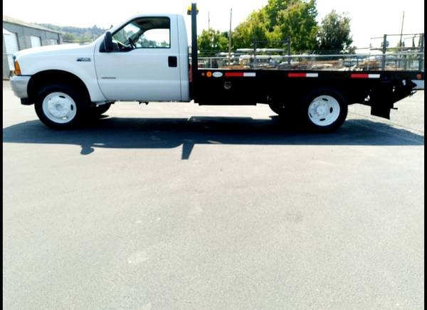 Photo 01 ford F450 7.3 powerstroke diesel 12quot flat bed 6sp - $9,450 (Portland ore)