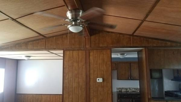 Photo 32 Vaulted ceilings. Very nice doublewide manufactured home. (1203 HWY 31, LONGVIEW TX)