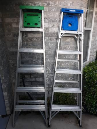 Photo Two aluminum 639 Step ladders - $20 (Flint)