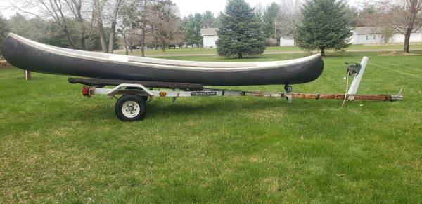 Photo 16 foot canoe, With Boat trailer, Trade. Trade trade. Or cash - $399 (Menomonie)
