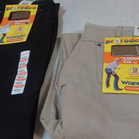 Photo MENS (NEW) WRANGLER JEANS - $15 (Eau Claire, WI)