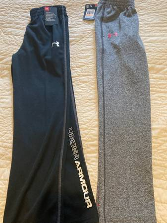 Photo 2 pairs NWT under armour boys pants - $25 (Corning)