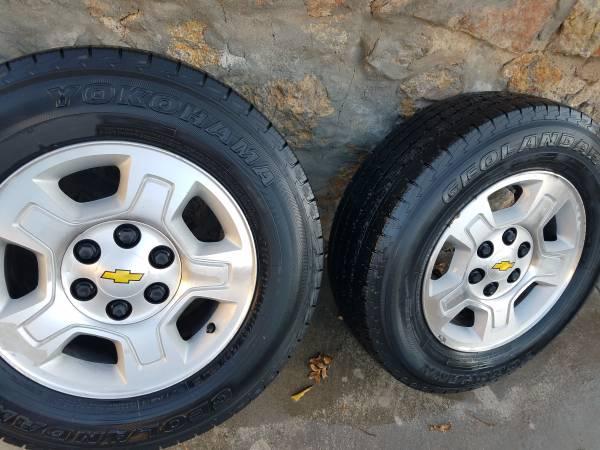 Photo Set of 4 Silverado  GMC factory OEM rims and tires-17 inch - $275 (El Paso)