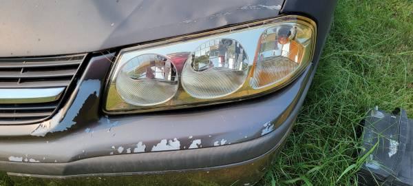 Photo 2002 Chevy Impala headlight assembly - $150 (Norman)
