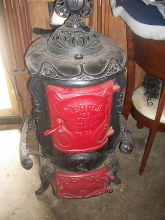 Photo Antique cast iron parlor stove. The Wehrle Co. Newark O - $900 (CONNEAUTVILLE)