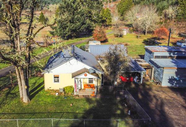Photo 37165 Row River Road with Small Rental on .96 Ac (Cottage Grove)
