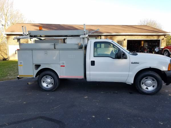 Photo 2006 Ford F350 service truck generator and air compressor - $9950