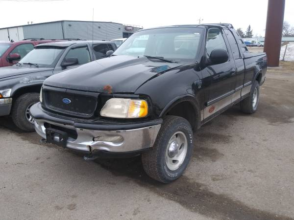 Photo KEEP THE LIGHTS ON SALE 1997 FORD F150 4X4 - $1500 (1918 E. MAIN AVE, West Fargo 58078)