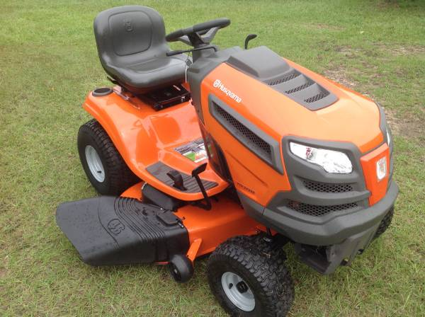 Photo Husquvarna riding lawn mower - $1,500 (Hope Mills)