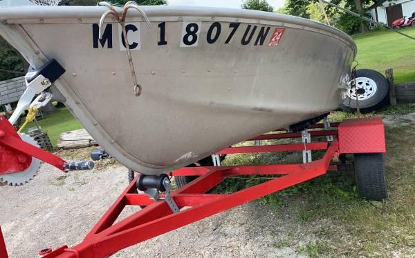 Photo 14 ft Ouachita aluminum boat with trailer - $1,600 (Clio)