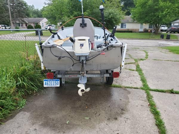 Photo 14 ft aluminum boat and 15hp Evinrude motor - $2,500 (Burton)