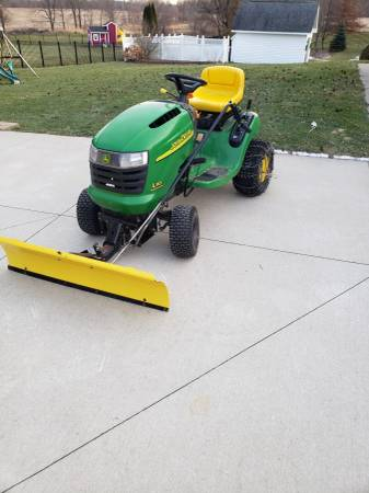 Photo John Deere L110 mower 42quot with snow plow, bagger,mulch,weights,chains - $600 (Flushing)