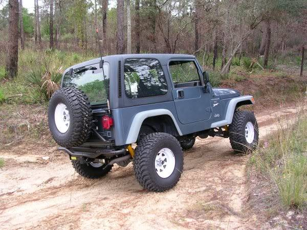 Photo 4- NEW WHITE FACTORY 1988 JEEP WRANGLER TJYJ RIMS WH HUBS - $400 (FLORENCE, S.C.)