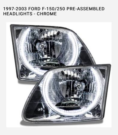 Photo 97-03 Ford headlights - $300 (Florence)