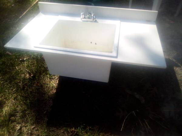 Photo A UTILITY SINK WITH COUNTER TOP - $100 (Summerville)